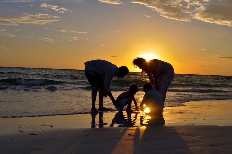 family-photoshoot-sunset-beach-Florida-waves-sundress